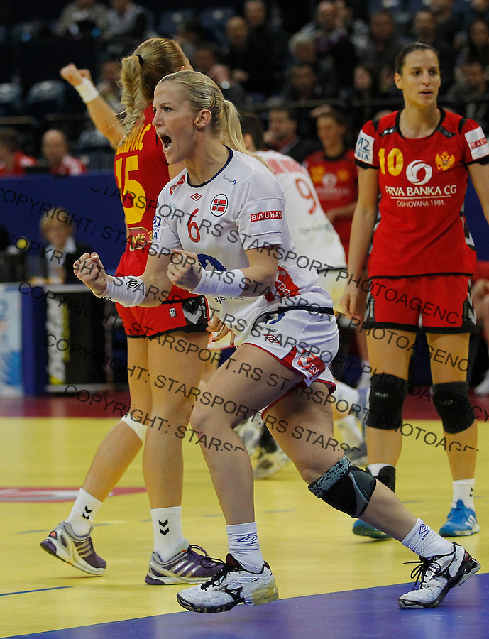 BELGRADE, SERBIA - DECEMBER 16: Heidi Loke (L) of Norway reacts during the Women's European Handball Championship 2012 gold medal match between Norway and Montenegro at Arena Hall on December 16, 2012 in Belgrade, Serbia. (Photo by Srdjan Stevanovic/Getty Images)