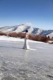 USA, Utah, Midway, Brooke an ice fishing bride has her wedding photos taken on the ice at Deer Creek Reservoir