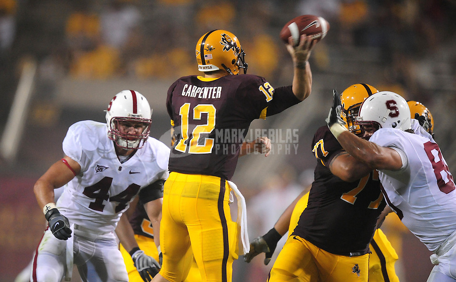 Sept 6, 2008; Tempe, AZ, USA; Arizona State University Sun Devils quarterback (12) Rudy Carpenter throws a pass in the first half against the Stanford Cardinal at Sun Devil Stadium. Mandatory Credit: Mark J. Rebilas-