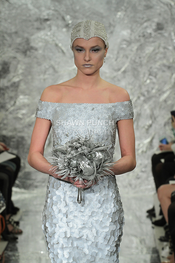 """Model Aida Aniulyte walks runway in Pamdé - a hand embroidered """"Scotchlite"""" laser cut paillette bridal gown, from the Theia Spring 2017 bridal collection by Don O'Neill, during New York Bridal Fashion Week Spring Summer 2017 on April 14, 2016."""