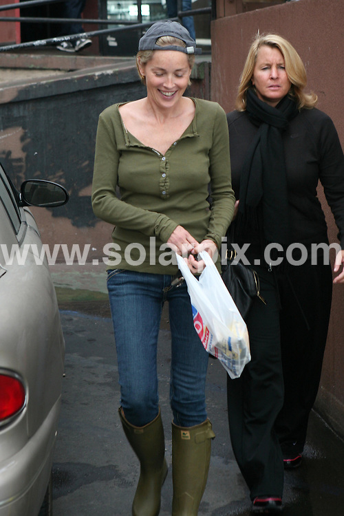 **ALL ROUND EXCLUSIVE PICTURES FROM SOLARPIX.COM**.**WORLDWIDE SYNDICATION RIGHTS**.**NO PUBLICATION IN AUSTRALIA, NEW ZEALAND,.DENMARK, GERMANY OR USA**.Sharon Stone has brunch with her friend at The Griddle Cafe in West Hollywood, wearing rubber boots and an Oscar Awards cap. West Hollywood, California, USA. 1st November 2008..JOB REF: 7775 LAP (NAS)       DATE: 01_11_2008.**MUST CREDIT SOLARPIX.COM OR DOUBLE FEE WILL BE CHARGED* *UNDER NO CIRCUMSTANCES IS THIS IMAGE TO BE REPRODUCED FOR ANY ONLINE EDITION WITHOUT PRIOR PERMISSION*