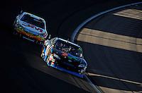 Mar 2, 2008; Las Vegas, NV, USA; NASCAR Sprint Cup Series driver Denny Hamlin (11) leads Greg Biffle during the UAW Dodge 400 at Las Vegas Motor Speedway. Mandatory Credit: Mark J. Rebilas-US PRESSWIRE