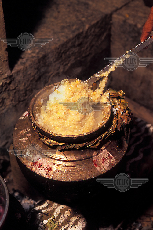 At start of the Pongal Harvest Festival, celebrating the beginning of the Tamil New Year, a pot of sweet Pongal, the rice dish after which the festival is named, is cooked on a traditional wood stove.
