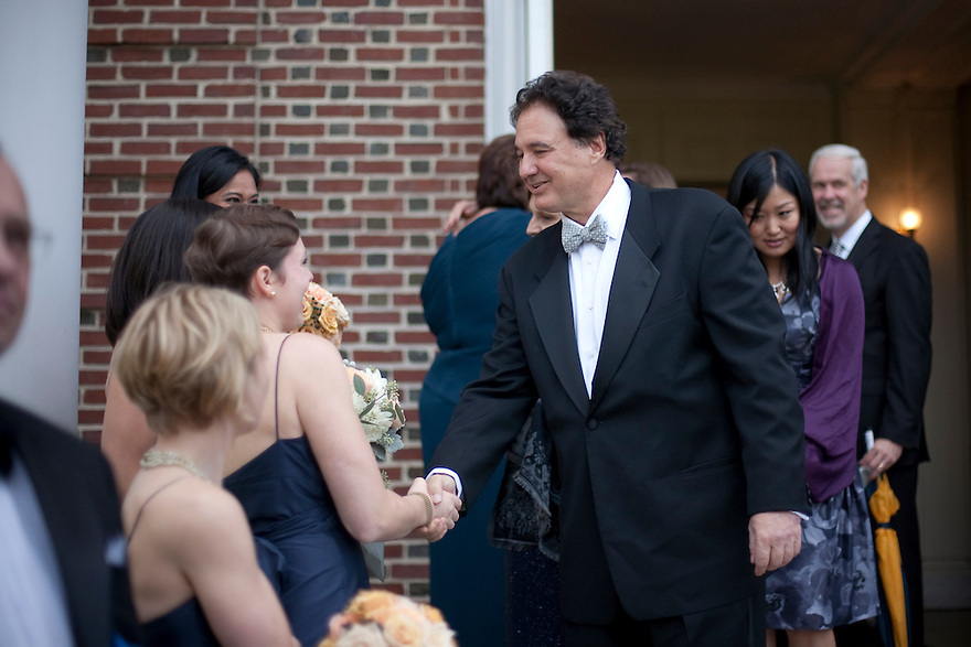 CONCORD, MA.-- October 15, 2011-- Steve Pagliuca, co-owner of the Boston Celtic and one-time candidate for Senate, greets the bridesmaids after the wedding ceremony. Victoria Bonney and Joseph Goodwin wed in Concord, Massachusetts. CREDIT: JODI HILTON FOR THE NEW YORK TIMES