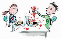 Boy squirting tomato ketchup over hamburger and making a mess
