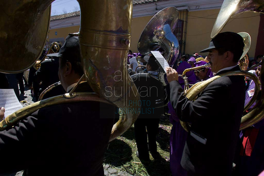 A brass band during the Procesión de Jesús Nazareno de La Caída from Iglesia San Bartolomé Becerra in Antigua, Guatemala. Each weekend during Lent features a procession by a different church, culminating in Semana Santa, or Holy Week, one of the largest Easter commemorations in Latin America.