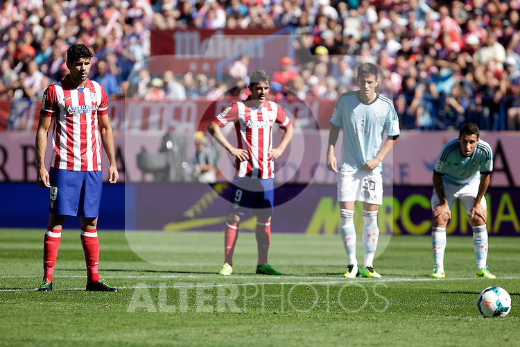 Atletico de Madrid´s Diego Costa (L) and Villa (2L) and Celta de Vigo´s Costas (R) during La Liga 2013/14 match. October 06, 2013. (ALTERPHOTOS/Victor Blanco)