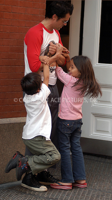 """""""Men in Black"""" star Johnny Knoxville plays with the kids outside his hotel in New York. August 19, 2003. Please byline: NY Photo Press.   ..*PAY-PER-USE*      ....NY Photo Press:  ..phone (646) 267-6913;   ..e-mail: info@nyphotopress.com"""