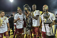 MEDELLÍN -COLOMBIA - 09-06-2018: Robin ramirez, Danovis Banguero, Julian Quiñones y Luis Payares jugadores del Tolima levantan el trofeo para celebrar como campeones después del encuentro de vuelta entre Atlético Nacional y Deportes Tolima por la final de la Liga Águila I 2018 jugado en el estadio Atanasio Girardot de la ciudad de Medellín. / Robin ramirez, Danovis Banguero, Julian Quiñones and Luis Payares players of Tolima lift the trophy to celebrate the tittle as champions of the Aguila League I 2018 after the second leg match between Atletico Nacional and Deportes Tolima for the final of the Aguila League I 2018 at Atanasio Girardot stadium in Medellin city. Photo: VizzorImage / Gabriel Aponte / Staff