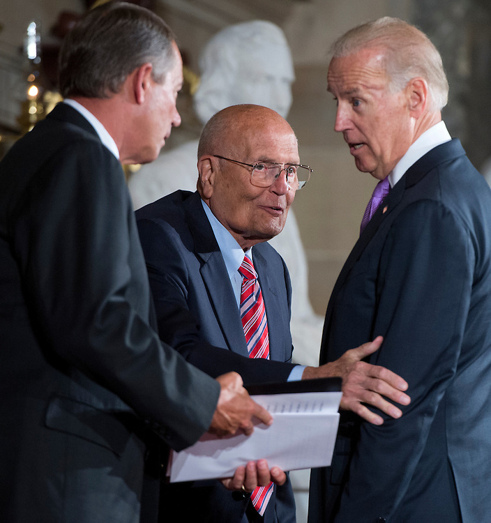 UNITED STATES - JUNE 13: Rep. John Dingell, D-Mich., center, is pictured with Vice President Joe Biden, right, and Speaker John Boehner, R-Ohio, in the Capitol's Statuary Hall during a ceremony to honor Dingell as the longest serving member of Congress. He came to Congress in 1955, filling his father's seat. (Photo By Tom Williams/CQ Roll Call)