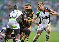 Christian Wade is tackled in possession. Aviva Premiership Double Header match, between London Wasps and Harlequins on September 7, 2013 at Twickenham Stadium in London, England. Photo by: Patrick Khachfe / Onside Images