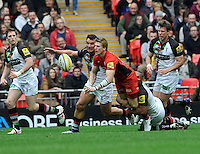 London, England. David Strettle of Saracens tackled during the Saracens and Harlequins Aviva Premiership with a world record crowd of 83,761 for a club rugby match at Wembley Stadium. 31March 2012 at Wembley Stadium, London, England,