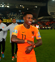 16th November 2019; Windsor Park, Belfast, Antrim County, Northern Ireland; European Championships 2020 Qualifier, Northern Ireland versus Netherlands; Quincy Promes of Netherlands leaves the pitch after the full time whistle - Editorial Use