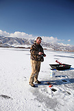 USA, Utah, Midway, Garrett ice fishing at Deer Creek Reservoir