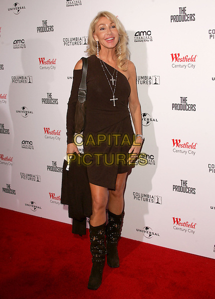 """LINDA THOMPSON.L.A. Premiere of """"The Producers"""" held at The New Century City AMC 15 Theatre in Century City, California.  .December 12th, 2005.Ref: DVS.full length one shoulder brown boots dress cross crucifix necklace.www.capitalpictures.com.sales@capitalpictures.com.Supplied By Capital PIctures"""