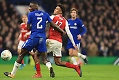 10th January 2018, Stamford Bridge, London, England; Carabao Cup football, semi final, 1st leg, Chelsea versus Arsenal; Alex Iwobi of Arsenal battles with Antonio Rudiger of Chelsea