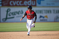 Frainyer Chavez (11) of the Hickory Crawdads hustles towards third base against the Greensboro Grasshoppers at L.P. Frans Stadium on May 26, 2019 in Hickory, North Carolina. The Crawdads defeated the Grasshoppers 10-8. (Brian Westerholt/Four Seam Images)