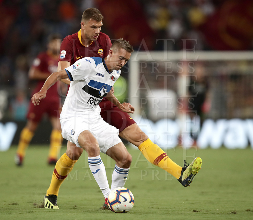 Calcio, Serie A: Roma - Atalanta, Stadio Olimpico, 27 agosto, 2018.<br /> Atalanta's Timothy Castagne (l) in action with Roma's Edin Dzeko (r) during the Italian Serie A football match between Roma and Atalanta at Roma's Stadio Olimpico, August 27, 2018.<br /> UPDATE IMAGES PRESS/Isabella Bonotto