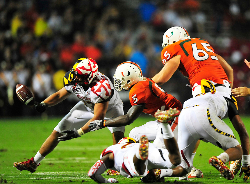 The Terrapins' Joe Vellano intercepts the ball. Maryland defeated Miami 32-24 during a game at the Byrd Stadium in College Park, MD on Monday, September 5, 2011. Alan P. Santos/DC Sports Box