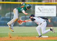 Kettle Run's David Stuart jumps over the tag of Liberty's Derek Dueling as Dueling attempted to pick him off as he came back to second base.