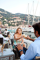 Pierre and Caroline drink pastis, a local speciality aperitif, at a cafe in the port of Villefranche-sur-Mer, France, 7 September 2012