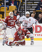 (Carroll) Alex Biega (Harvard - 3), Greg Costa (NU - 22) - The Northeastern University Huskies defeated the Harvard University Crimson 4-1 (EN) on Monday, February 8, 2010, at the TD Garden in Boston, Massachusetts, in the 2010 Beanpot consolation game.