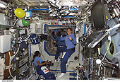 FILE: In this photo released by NASA, Astronauts Stephanie D. Wilson (left) and Lisa M. Nowak, both missions for STS-121, check out camera gear during their personal inaugural space flights and during their first day onboard the International Space Station in Earth orbit on July 6, 2006.<br /> Credit: NASA via CNP