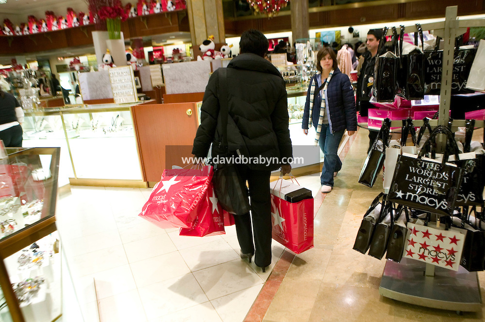 6 December 2006 - New York City, NY - People shop inside the Macy's department store in New York City, USA, 6 December 2006.