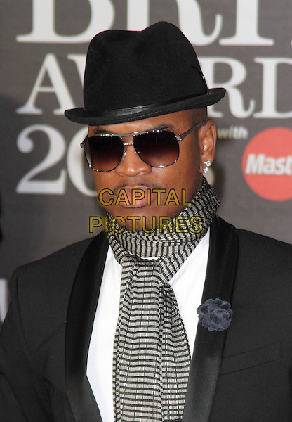 (Shaffer Chimere Smith).Arrivals for The 2013 Brit Awards at the O2 Arena, London, England..February 20th 2013.BRITS headshot portrait black hat sunglasses shades scarf striped scarf grey gray suit jacket flower corsage.CAP/ROS.©Steve Ross/Capital Pictures