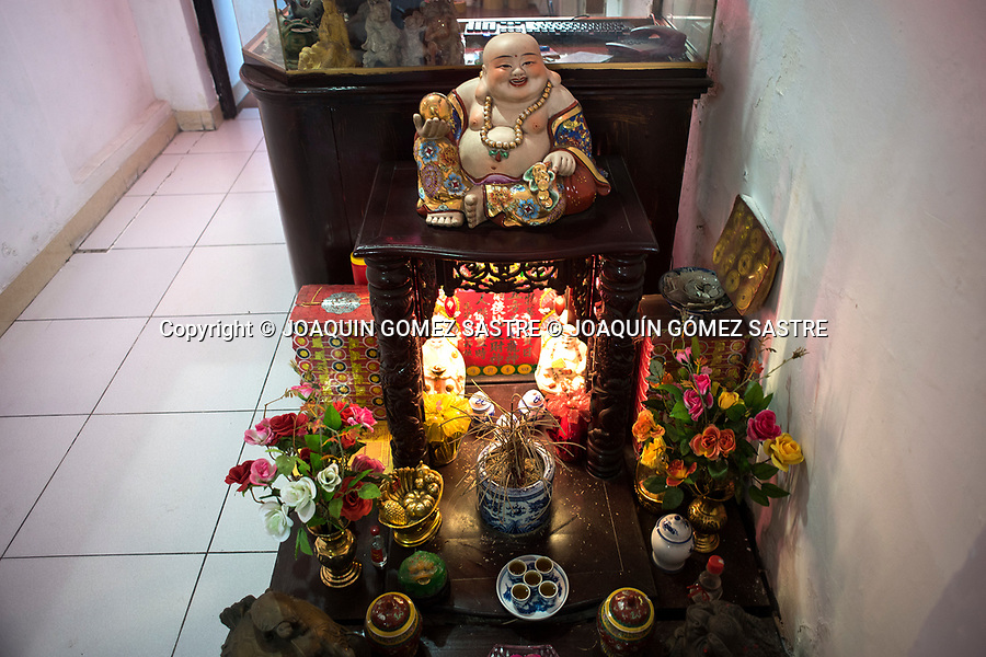 Altar dedicated to Buddha at the entrance of a house in Hanoi (vietnam)<br /> HANOI-VIETNAM