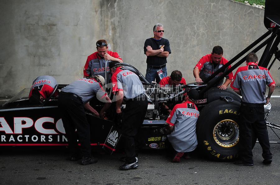 Jun. 3, 2012; Englishtown, NJ, USA: Crew members for NHRA top fuel dragster driver Steve Torrence during the Supernationals at Raceway Park. Mandatory Credit: Mark J. Rebilas-