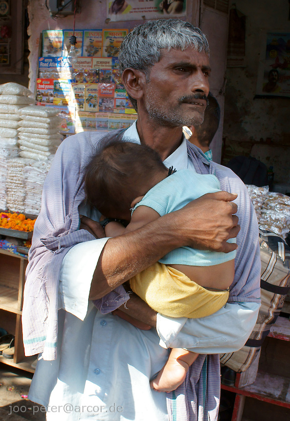 father and child in holy city Pushkar, Rajastan, India