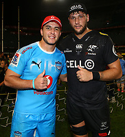 DURBAN, SOUTH AFRICA - APRIL 14: Burger Odendaal (captain) of the Vodacom Blue Bulls with Ruan Botha (captain) of the Cell C Sharks during the Super Rugby match between Cell C Sharks and Vodacom Bulls at Jonsson Kings Park Stadium on April 14, 2018 in Durban, South Africa. Photo: Steve Haag / stevehaagsports.com