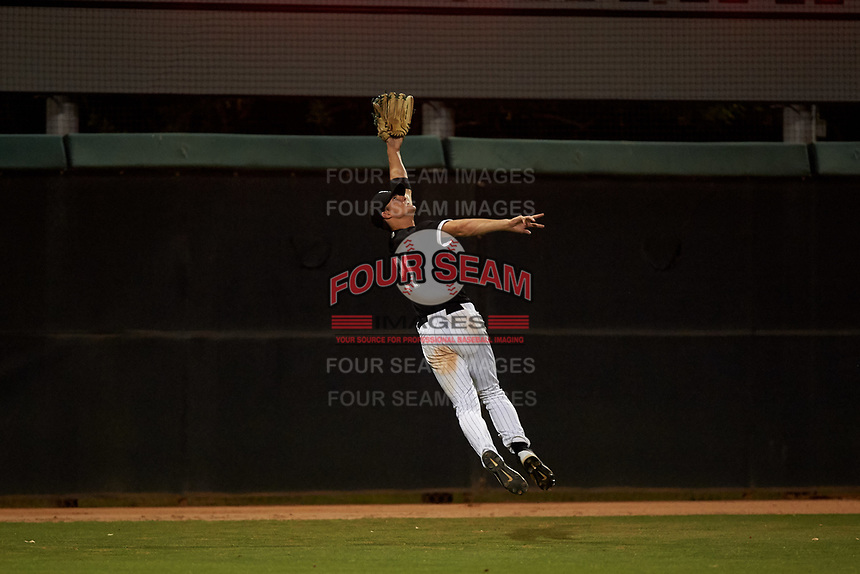 AZL White Sox left fielder Jonathan Allen (21) attempts to make a catch during an Arizona League game against the AZL Indians Blue on July 2, 2019 at Camelback Ranch in Glendale, Arizona. The AZL Indians Blue defeated the AZL White Sox 10-8. (Zachary Lucy/Four Seam Images)