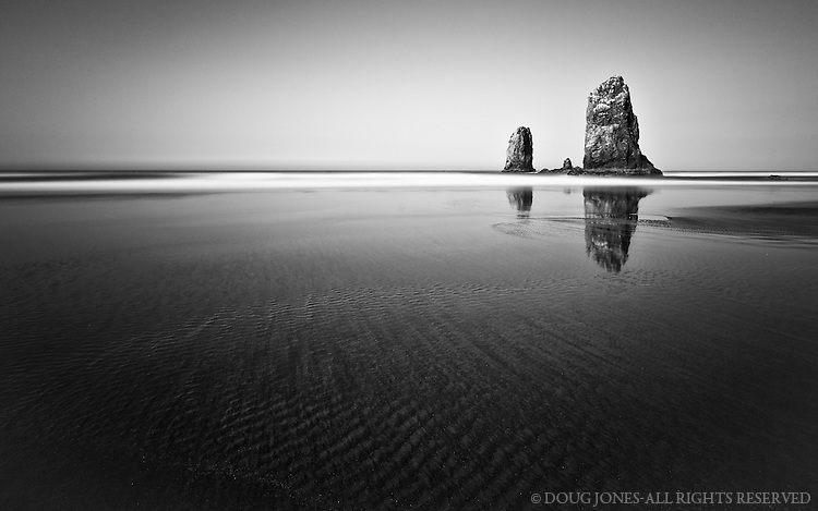 An 8 minute exposure of Haystack Rocks on Cannon Beach, Oregon.  A perfectly clear morning made for ideal conditions.