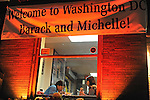 A sign welcoming Barack and Michelle to Washington hangs over a sandwich shop near Dupont Circle in Washington, DC on January 14, 2008.