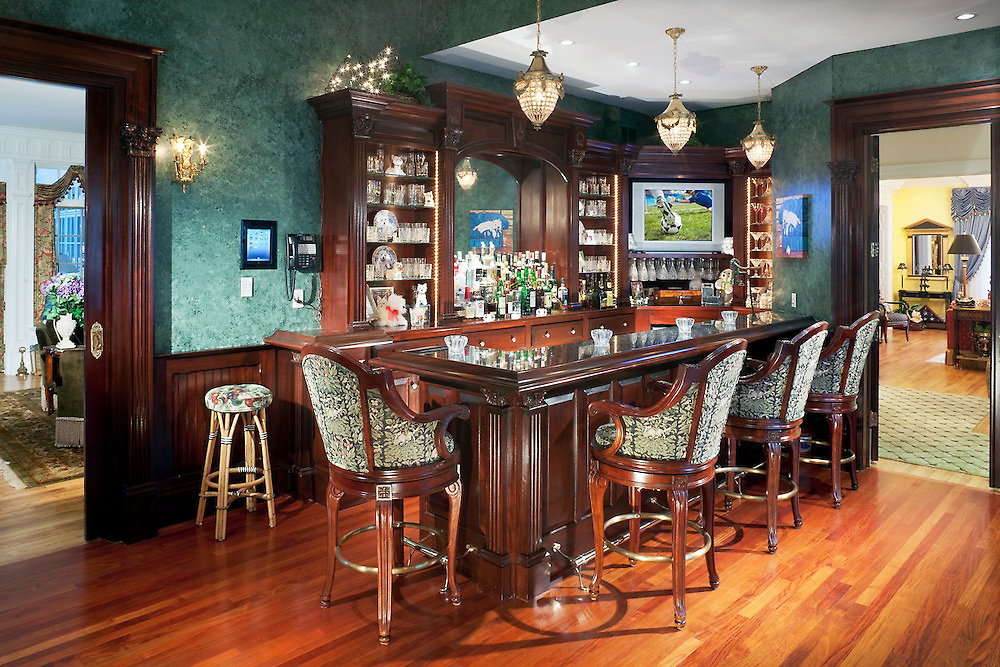 Take game day to the next level with a customized bar area in your own home.
