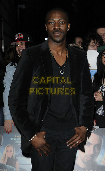 David Ajala.The 'Payback Season' UK film premiere, Odeon Covent Garden cinema, Shaftesbury Avenue, London, England..March 6th, 2012.half length black suit jacket.CAP/CAN.©Can Nguyen/Capital Pictures.
