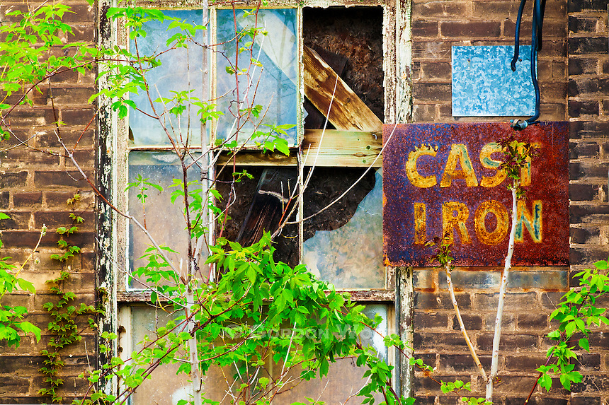 Abandoned Factory with Rusted Metal Sign