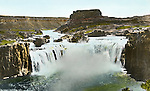 Twin Falls ID:  View of the Shoshone Falls  - 1910.  Brady Stewart and three friends went to Idaho on a lark from 1909 thru early 1912.  As part of the Mondell Homestead Act, they received a grant of 160 acres north of the Snake River.  Brady Stewart photographed the adventures of farming along with the spectacular landscapes. To give family and friends a better feel for the adventure, he hand-color black and white negatives into full-color 3x4 lantern slides.  The Process:  He contacted a negative with another negative to create a positive slide.  He then selected a fine brush and colors and meticulously created full color slides.