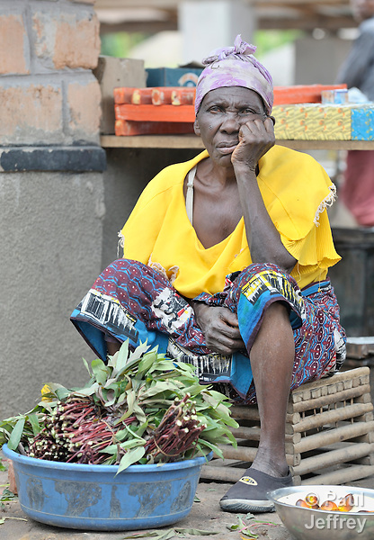 A woman sells vegetables in a market in Kamina, in the Democratic Republic of the Congo. Constructed by the United Methodist Committee on Relief (UMCOR), the market provides local residents a healthy environment to sell their products.