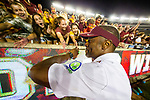Florida State Seminoles head coach Willie Taggart gives high fives as he runs along the student section after defeating North Carolina State 31-13 in an NCAA college football game in Tallahassee, Fla., Saturday, Sept. 28, 2019.  (AP Photo/Mark Wallheiser)