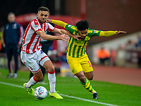 4th November 2019; Bet365 Stadium, Stoke, Staffordshire, England; English Championship Football, Stoke City versus West Bromwich Albion; Tommy Smith of Stoke City tackles Matheus Pereira of West Bromwich Albion - Strictly Editorial Use Only. No use with unauthorized audio, video, data, fixture lists, club/league logos or 'live' services. Online in-match use limited to 120 images, no video emulation. No use in betting, games or single club/league/player publications