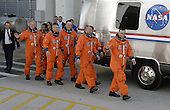 Cape Canaveral, FL - March 15, 2009 - The STS-119 crew members head for the Astrovan to take them to Launch Pad 39A at NASA's Kennedy Space Center in Florida for launch of space shuttle Discovery to the International Space Station. From left are Mission Specialists John Phillips, Koichi Wakata, Steve Swanson and Richard Arnold, Pilot Tony Antonelli, Mission Specialist Joseph Acaba (behind Antonelli) and Commander Lee Archambault. Wakata represents the Japan Aerospace Exploration Agency and will remain on the International Space Station, replacing Expedition 18 Flight Engineer Sandra Magnus, who returns to Earth with the STS-119 crew. Liftoff of Discovery is scheduled for 7:43 p.m. EDT on Sunday, March 15, 2009. An earlier launch attempt March 11 was scrubbed at 2:36 p.m. due to a gaseous hydrogen leak from the external tank at the Ground Umbilical Carrier Plate during tanking. A seven-inch quick disconnect and two seals were replaced. The STS-119 mission is the 28th to the space station and the 125th space shuttle flight. Discovery will deliver the final pair of power-generating solar array wings and the S6 truss segment. Installation of S6 will signal the station's readiness to house a six-member crew for conducting increased science. .Credit: Kim Shiflett - NASA via CNP