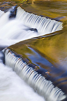 A unique shaped ledge waterfall on the Middle Branch of the Ontonagon River at Bond Falls State Scenic Site near Watersmeet Michigan in the Upper Peninsula.