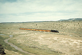 A distant shot of Rocky Mountain Railroad Club excursion train possibly east of Durango.<br /> D&amp;RGW