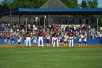 """Batavia Muckdogs players including Mike Garzillo (3), Kris Goodman (8), Samuel Castro (25) and J.J. Gould (49) stand with the """"Stars of the Game"""" for the national anthem before a game against the State College Spikes on June 24, 2016 at Dwyer Stadium in Batavia, New York.  State College defeated Batavia 10-3.  (Mike Janes/Four Seam Images)"""