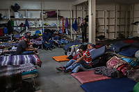 MEXICALI, MEXICO - February 20. A group of migrants rest in the Alfa y Omega Shelter on February 20, 2019 in Mexicali, Mexico.<br />  A new group of Central American migrants arrived to the city, mostly young men. Some manifest their desire to remain on Mexican soil but for others the idea of crossing the border fence is still attractive.<br /> US President Donald Trump uses emergency powers to secure funding for his proposed US-Mexico border wall. In this case, Trump has claimed there is a migration crisis on the US-Mexico border.<br /> (Photo by Luis Boza/VIEWpress/<br /> (Photo by Luis Boza/VIEWpress)