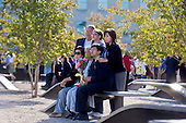 Family members sit on the memorial bench of their loved one who died during the September 11, 2001 terror attack during a ceremony the Pentagon Memorial marking the ninth anniversary of the September 11 attacks, Saturday, September 11, 2010. .Mandatory Credit: Cherie Cullen - DoD via CNP