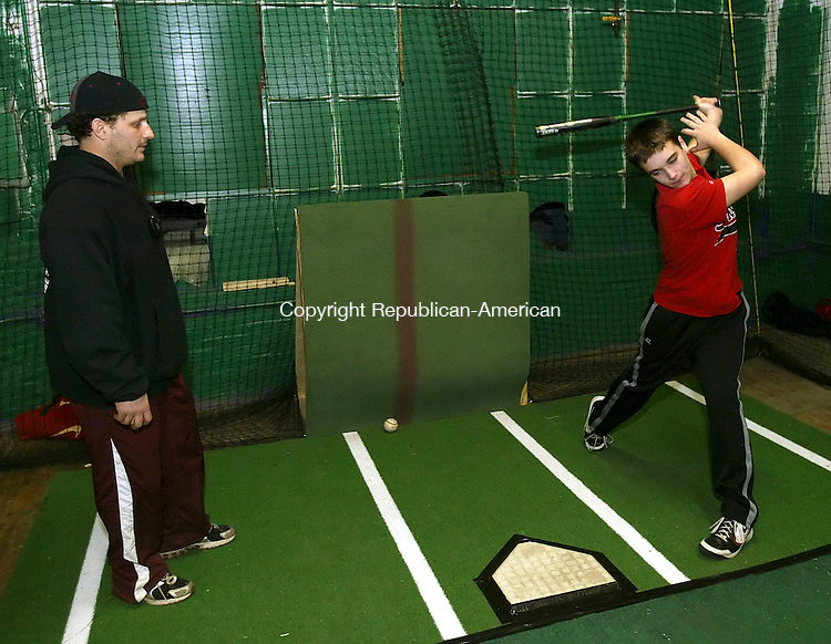 WATERTOWN, CT 01/09/08-010908BZ16- Former Major League outfielder Darren Bragg watches Kyle Plourde, 13, of Southbury, take a practice swing during instruction at The Hit Club in Thomaston Wednesday night.<br /> Jamison C. Bazinet Republican-American